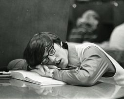 sleeping in the library -- black and white