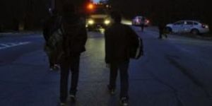 students-approach-school-bus-in-darkness