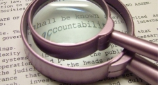 Accountability magnifying glass -- tvinemedia