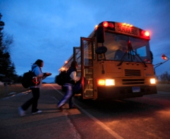 boarding bus in early a.m.